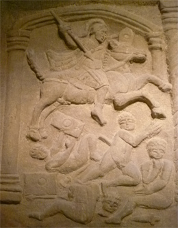 The Bridgeness Slab depicting Roman Cavalry attacking Caledonian warriors.