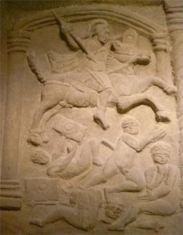 The Bridgeness Slab depicting Roman Cavalry attacking Caledonian warriors.
